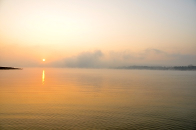 The sun rises on river Sonbhadra and