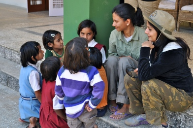 Surrounded by tribal girls at a forest rest house